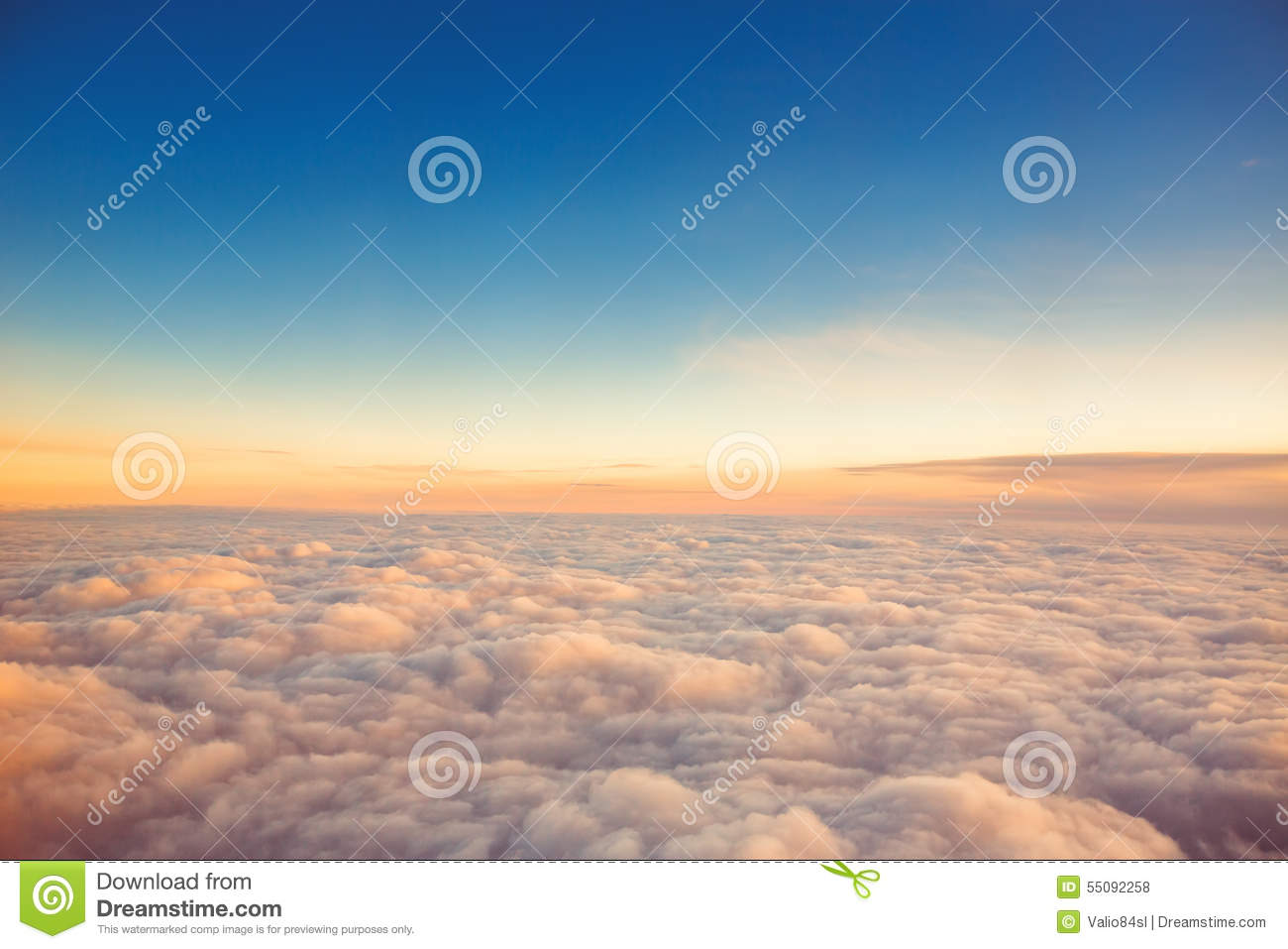 Flying above the clouds view from the airplane sunset shot stock download comp thecheapjerseys Choice Image