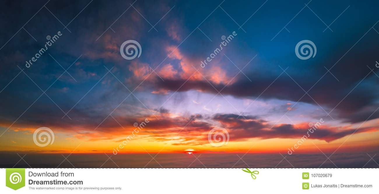 Flying between the cloud at sunset