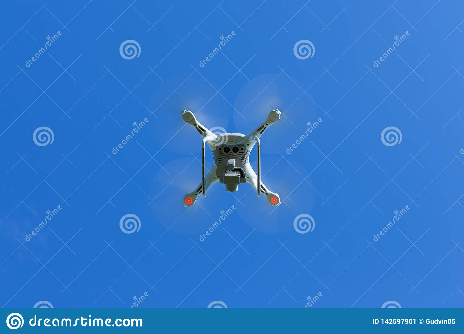 Flying drone with blue sky background controlled by professional