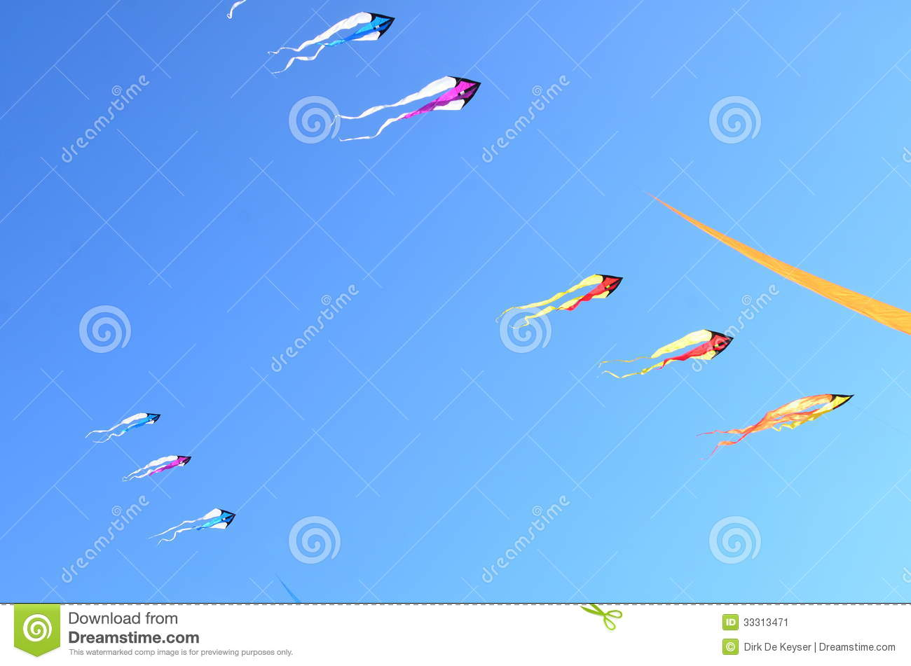Flying kites in a blue sky