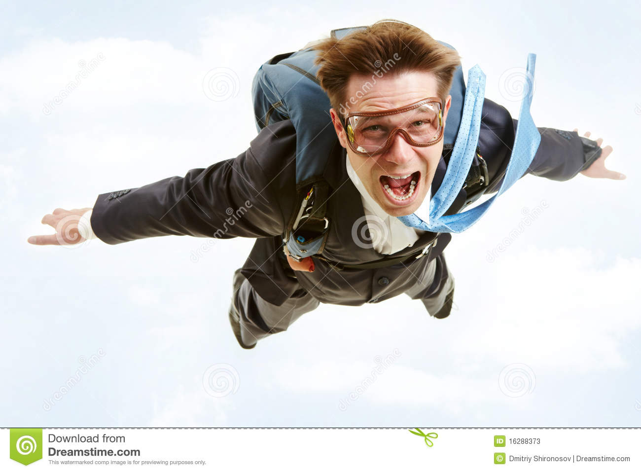 Conceptual image of young businessman flying with parachute on back.