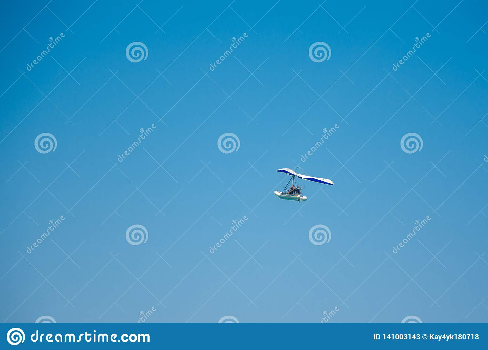 Flying motor boat in the clear blue sky