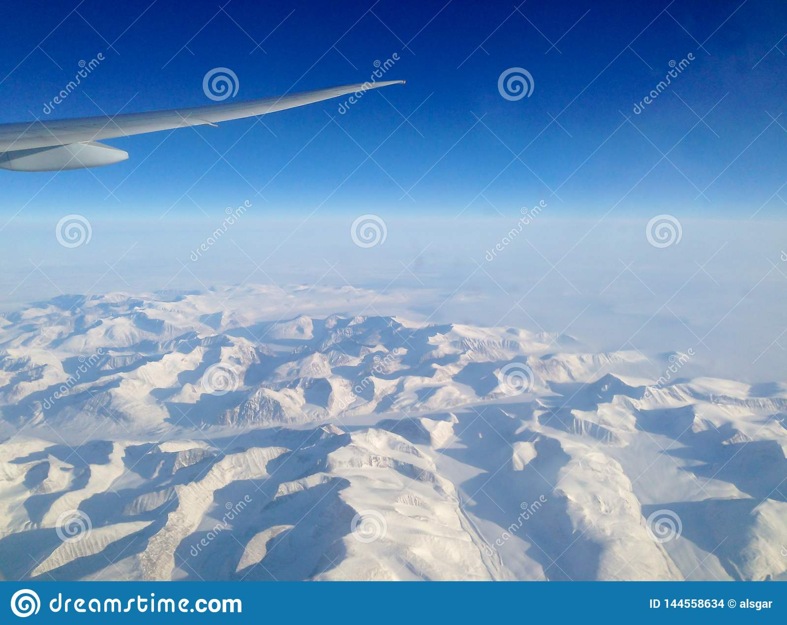 Flying north over the ice sheets of Greenland