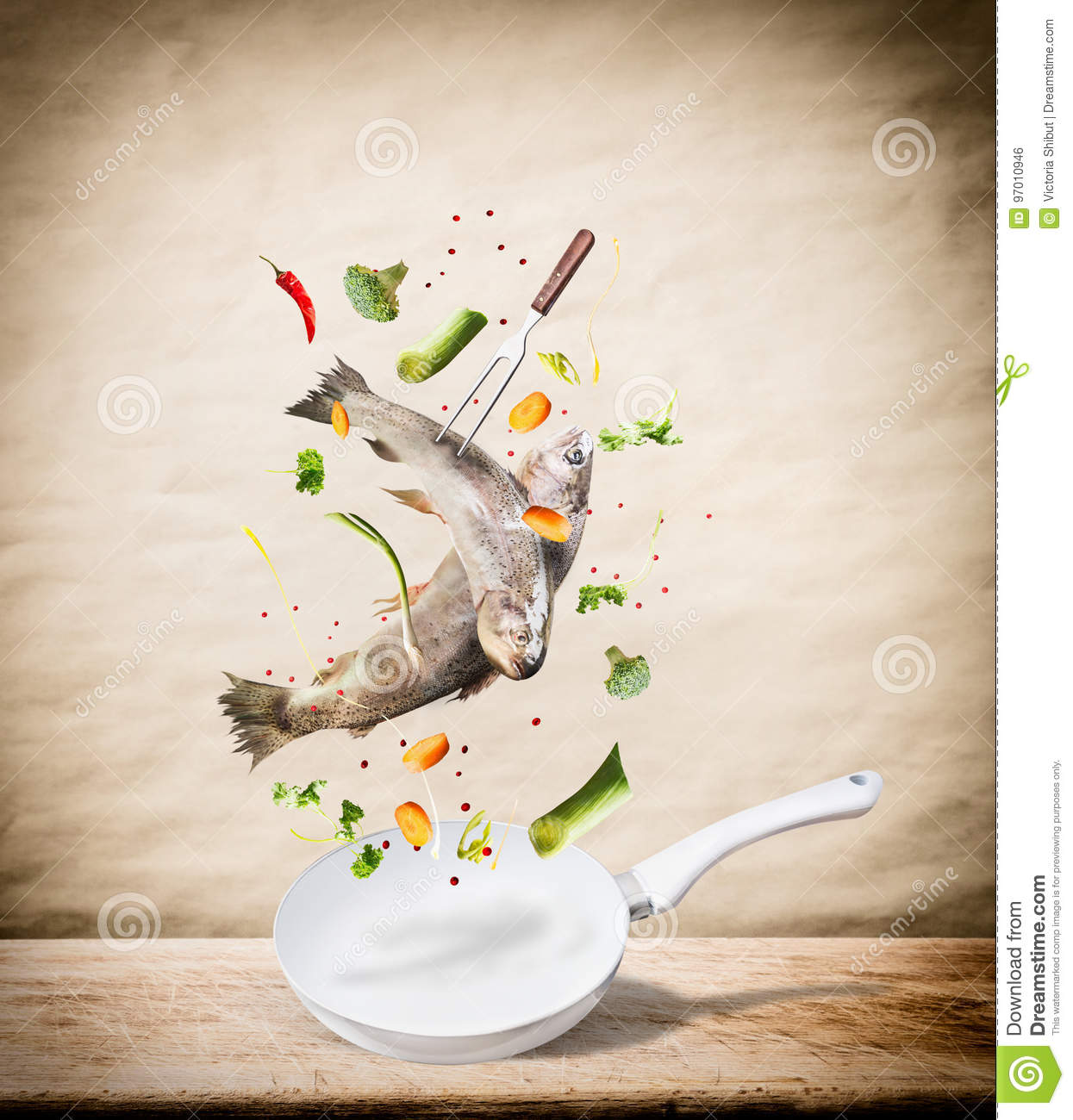 Flying Raw Whole Trout Fishes With Vegetables, Oil And Spices ...