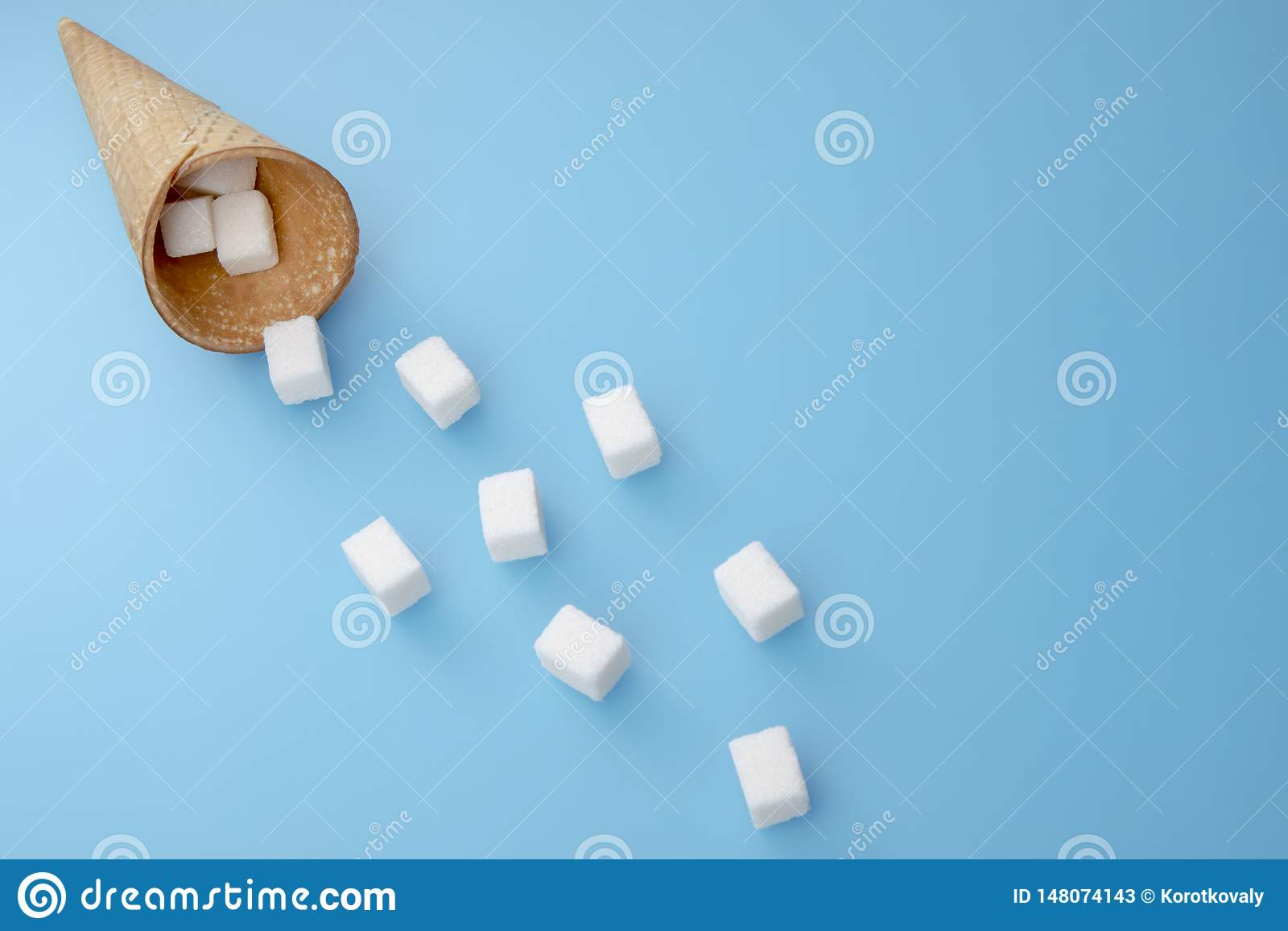 Sugar cubes from ice cream cone. Copy space for text. Top view