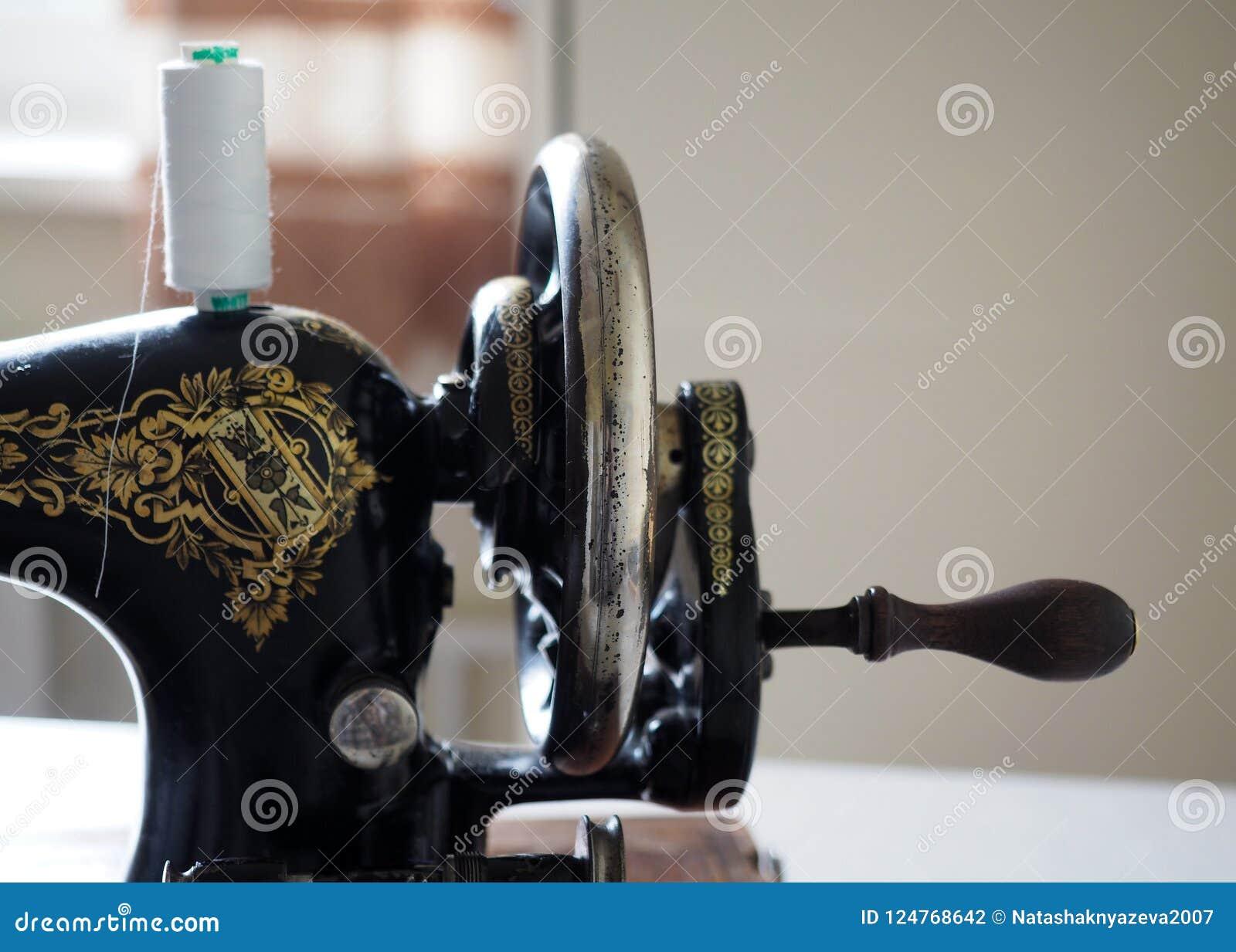 The flywheel of old vintage manual sewing machine