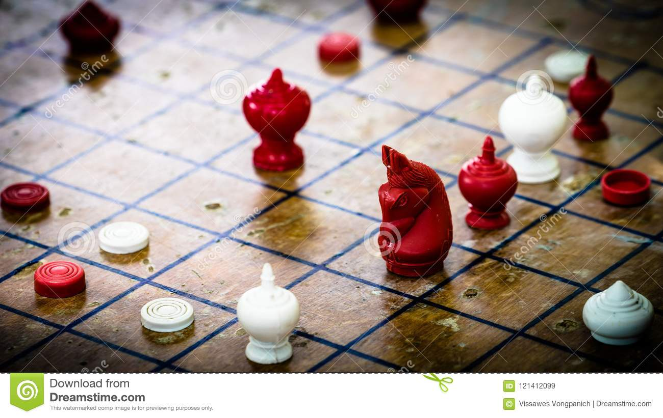 Focus at Agressive Red Horse figure, Thai Chess on Wood Board, T