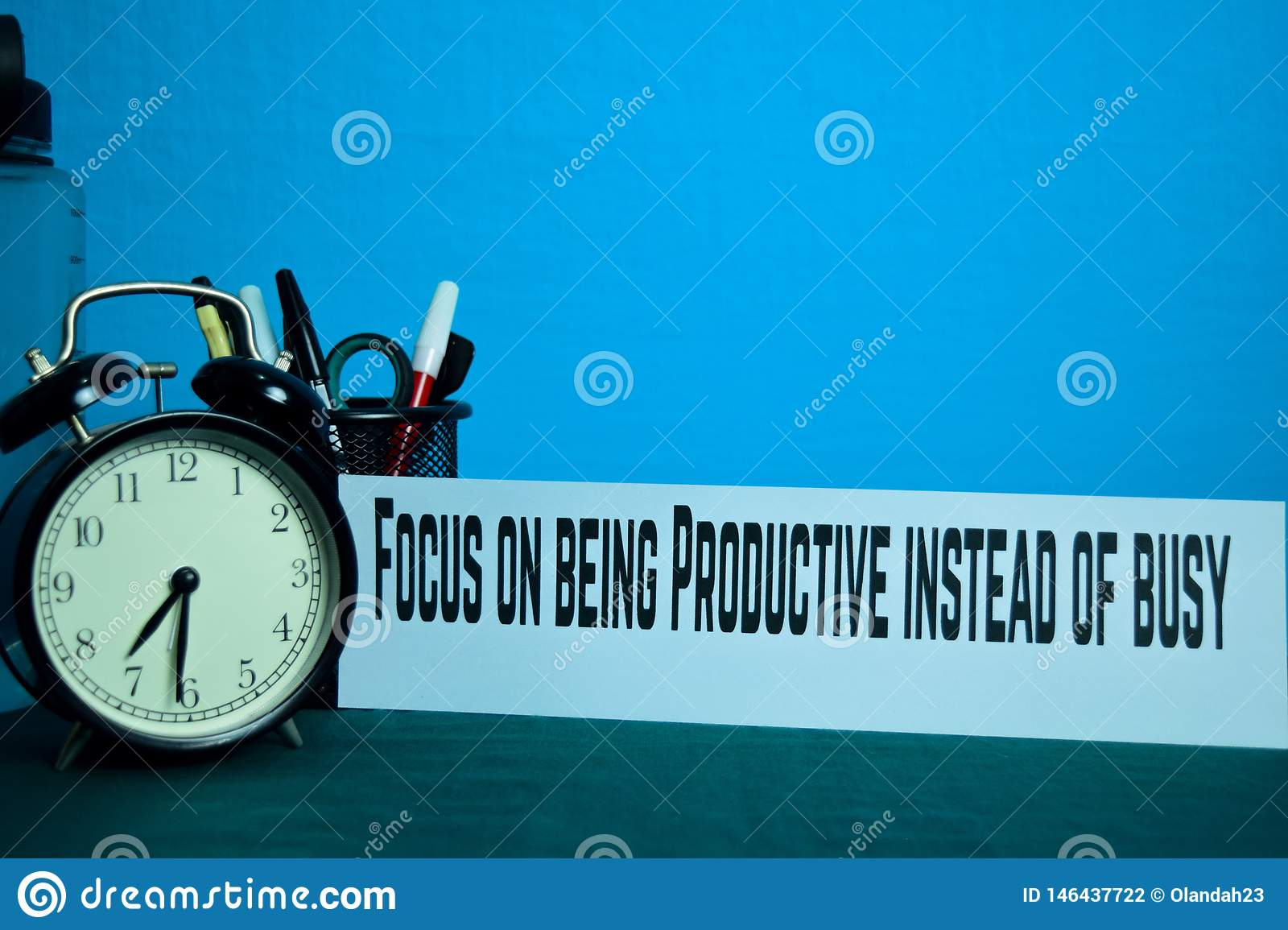 Focus on being Productive instead of busy Planning on Background of Working Table with Office Supplies.