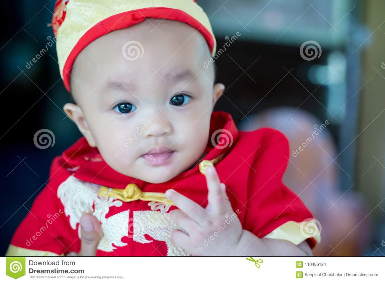 focus cute baby boy wear red and gold chinese suit on chinese new