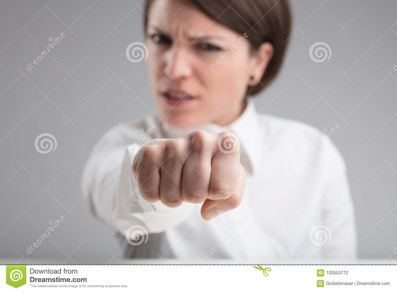 Focus on a punch of an angry woman