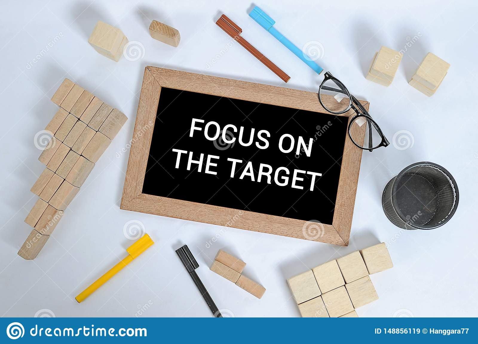 FOCUS ON THE TARGET text on blackboard with office accessories. Business motivation, inspiration concepts, pen and pencil case,
