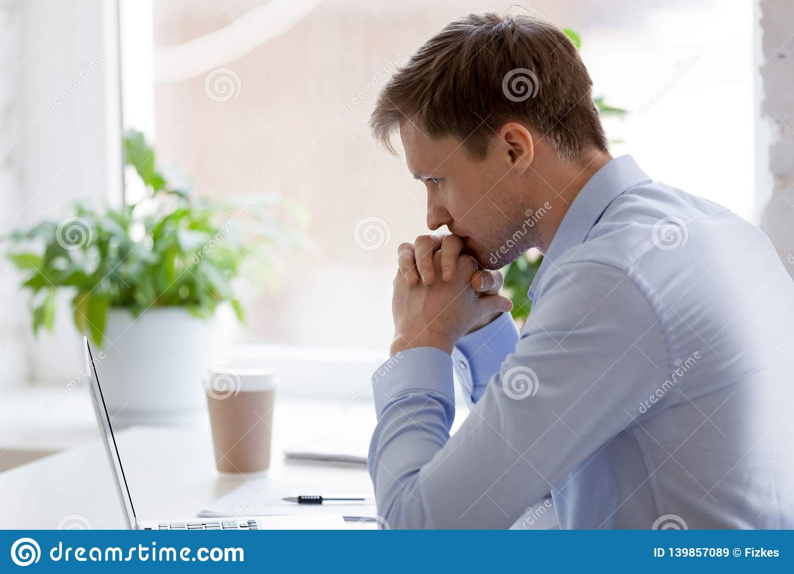 Focused businessman sitting in office working and thinking