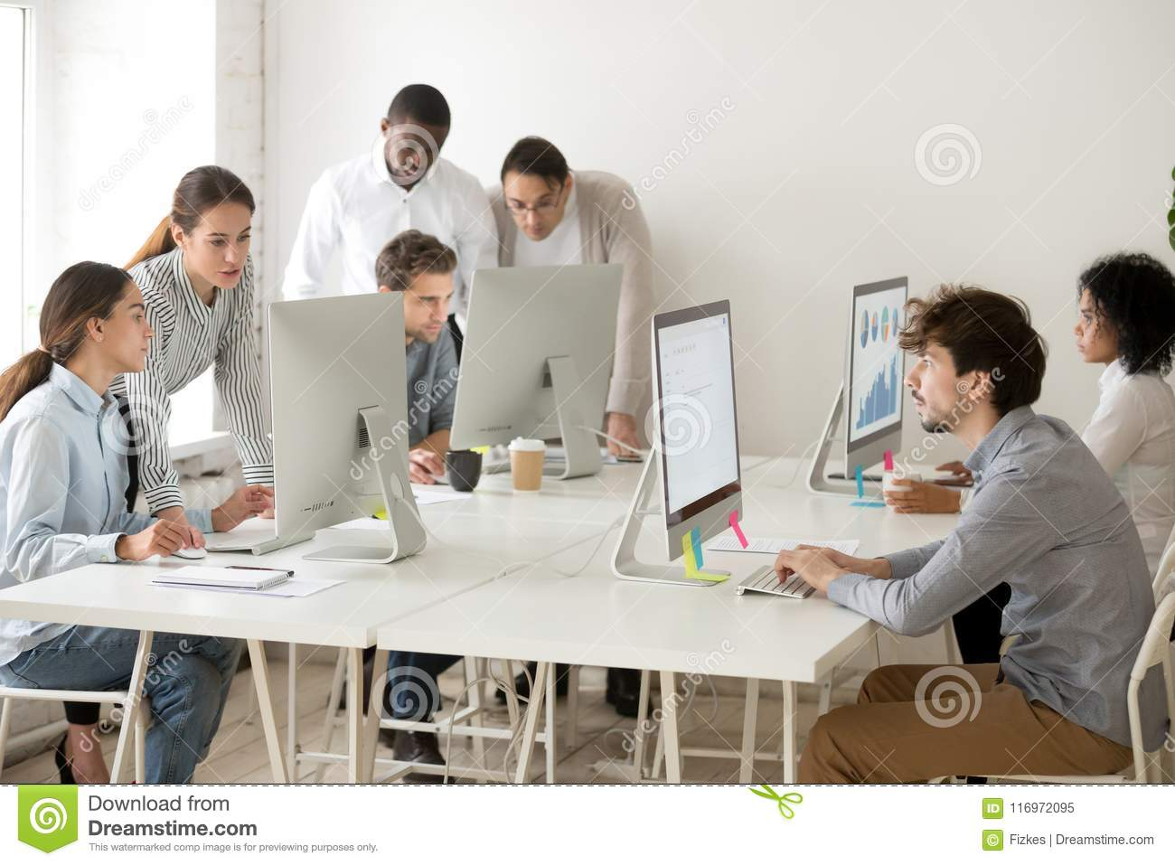 Focused multiracial business people working online on computers