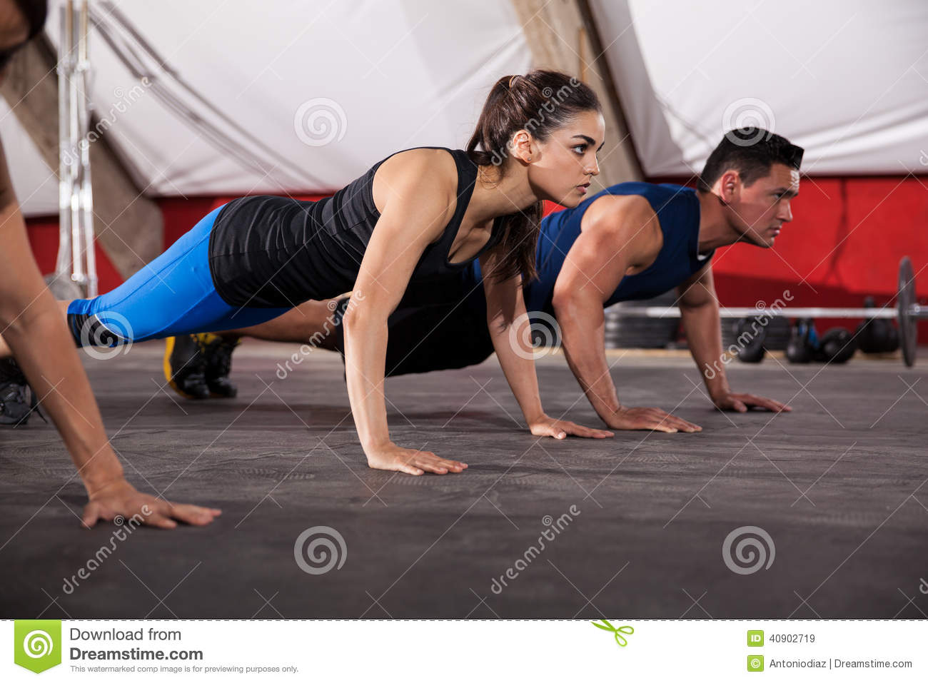 Focused on her push ups