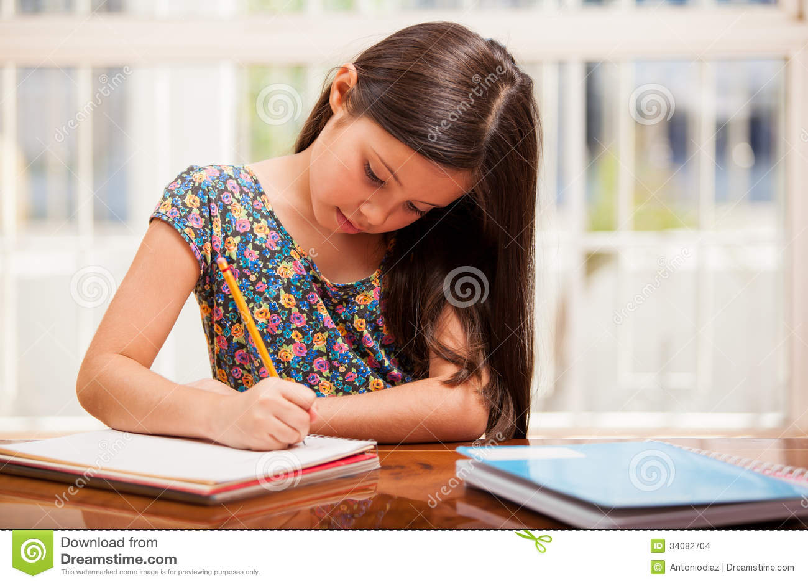 Girl Studying In Living Room