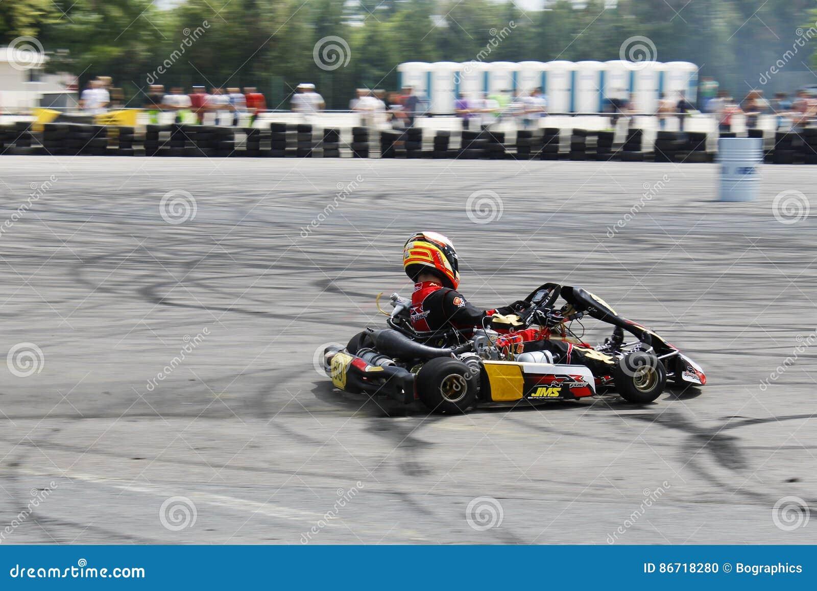 Download Focused Kart Racing Driver On Circuit Drifting Editorial Image - Image of drift, wheels: 86718280