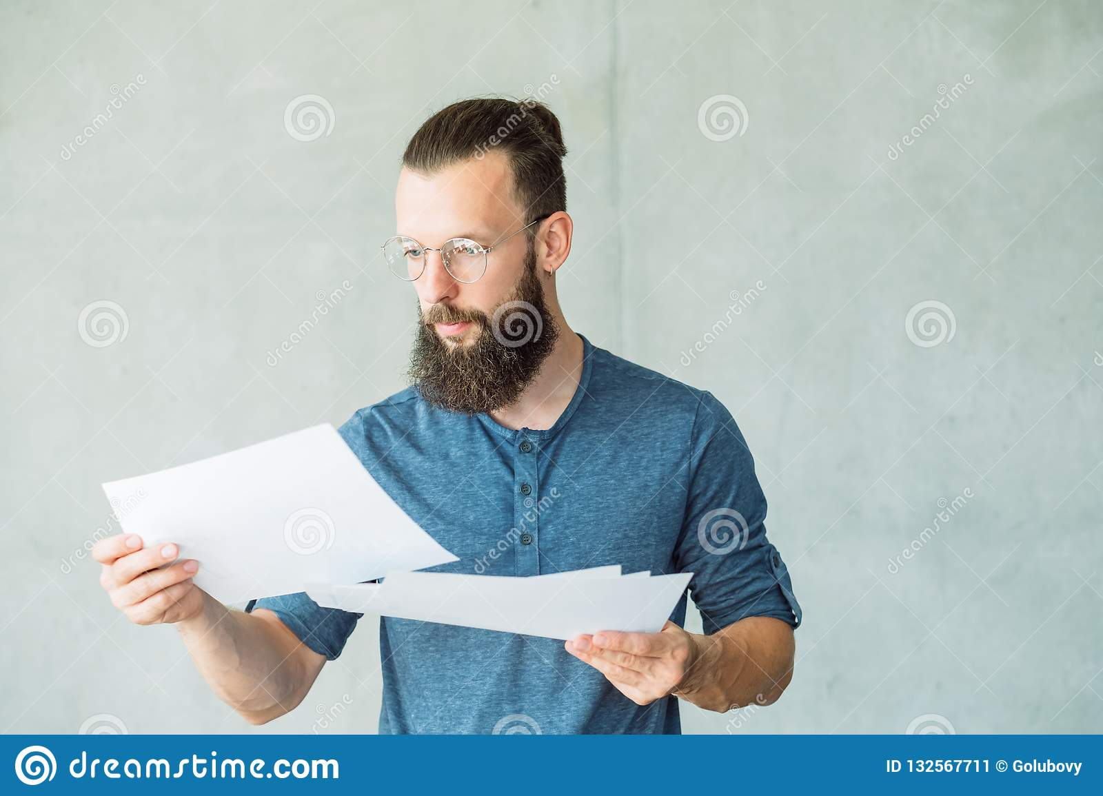 Focused man read business documents information