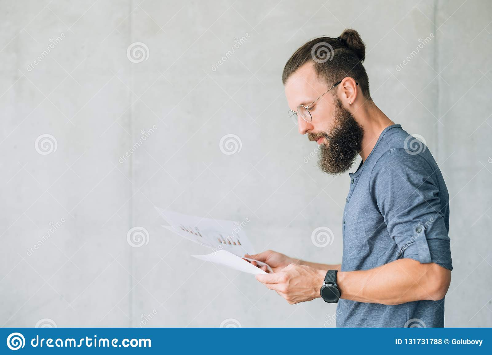 Focused man read document information report data