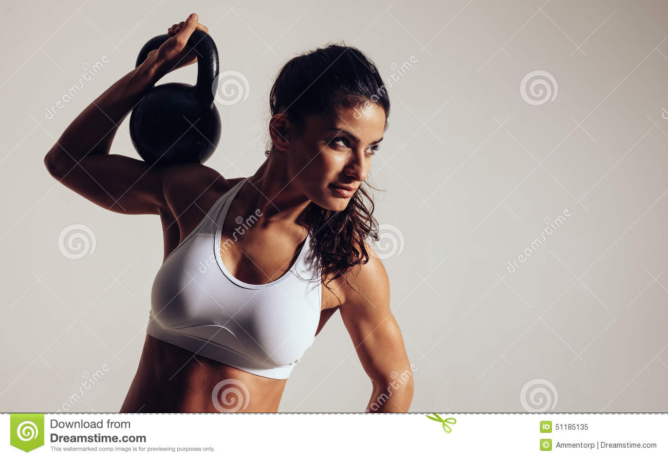Focused young woman doing crossfit