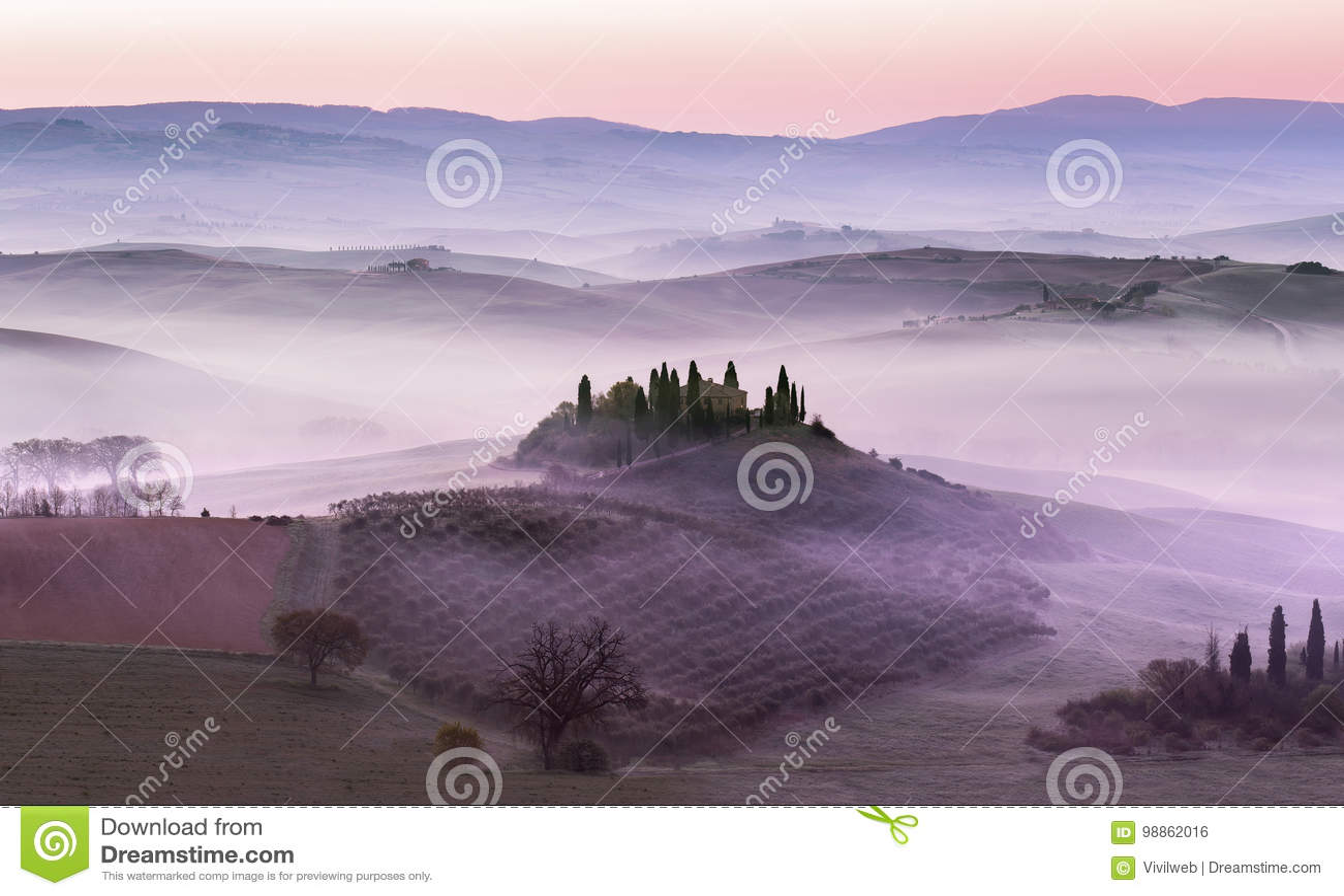 Foggy dawn on countryside hills