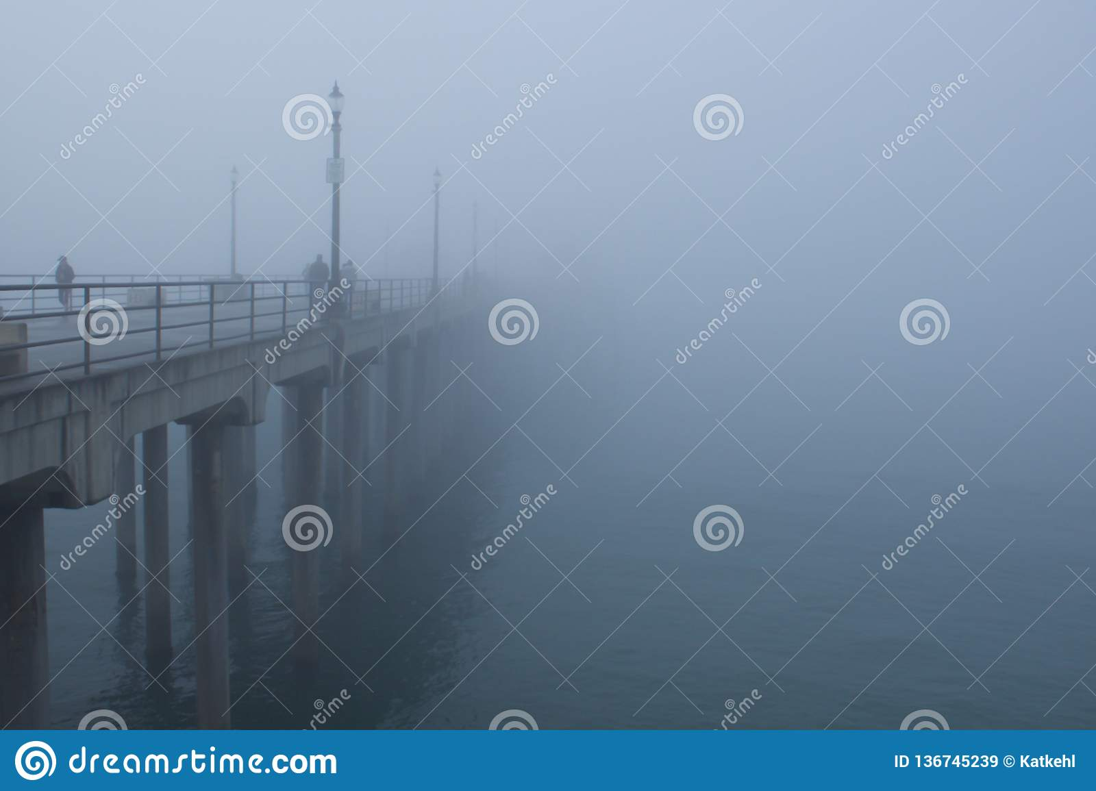 Foggy morning over the ocean and pier