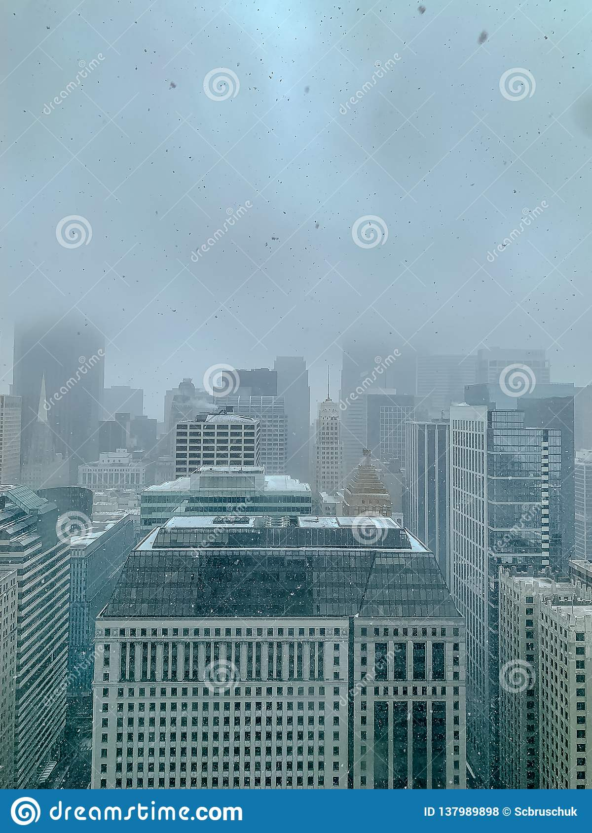 Aerial view of skyscrapers on a foggy, snowy day in Chicago during January