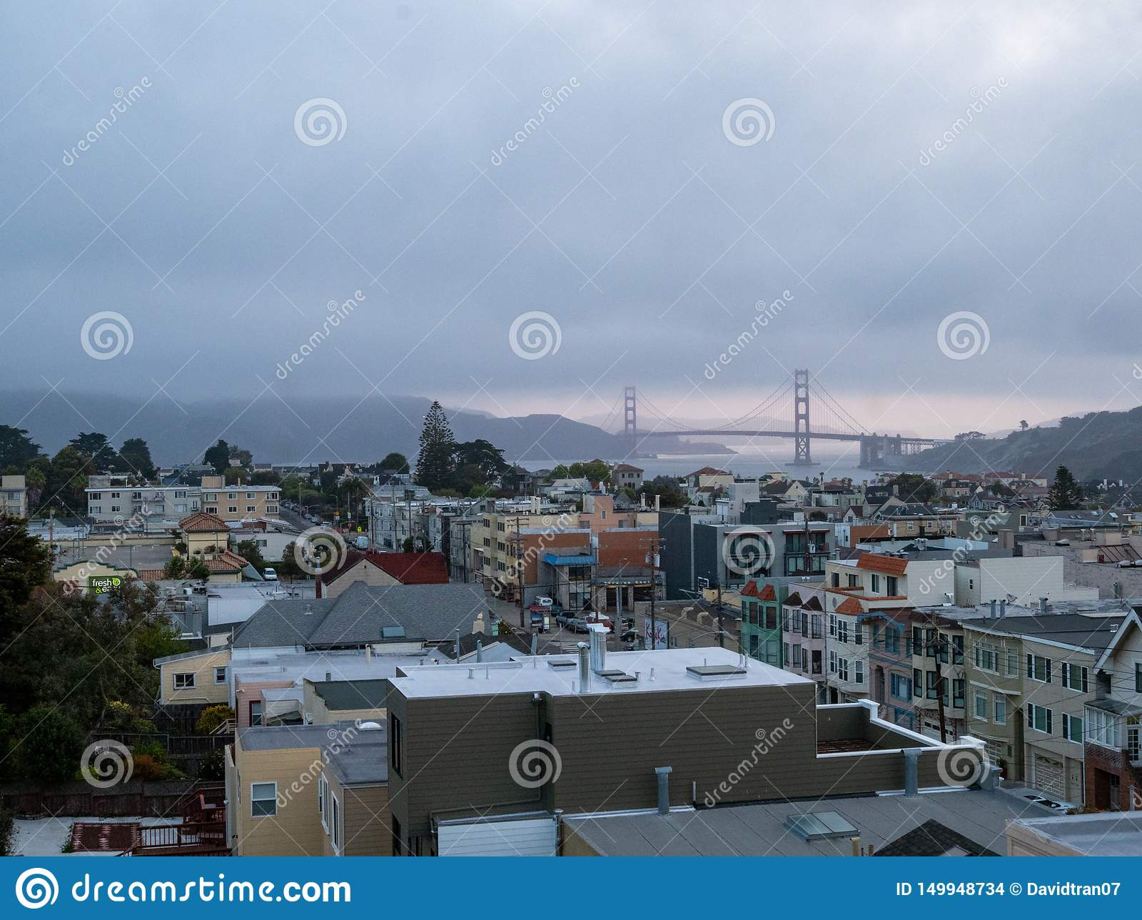 Foggy view of Golden Gate Bridge and Marin Headlands from west side of city