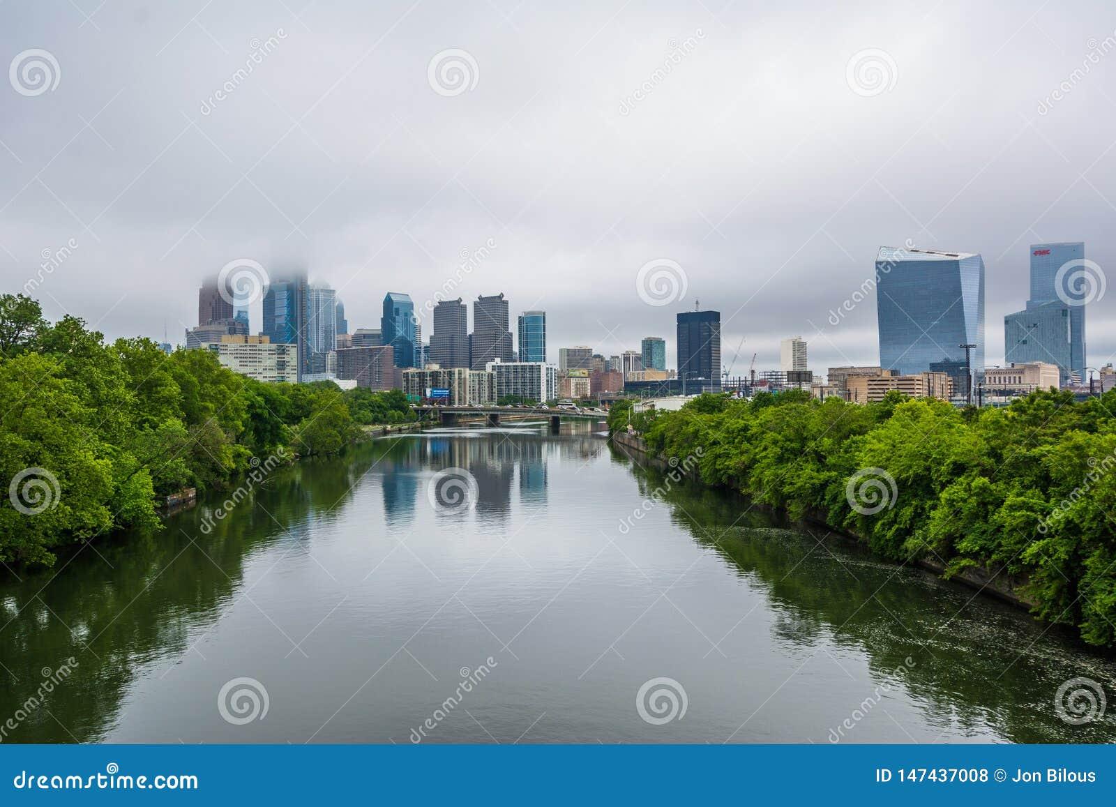 Foggy view of the Philadelphia skyline and Schuylkill River in Philadelphia, Pennsylvania
