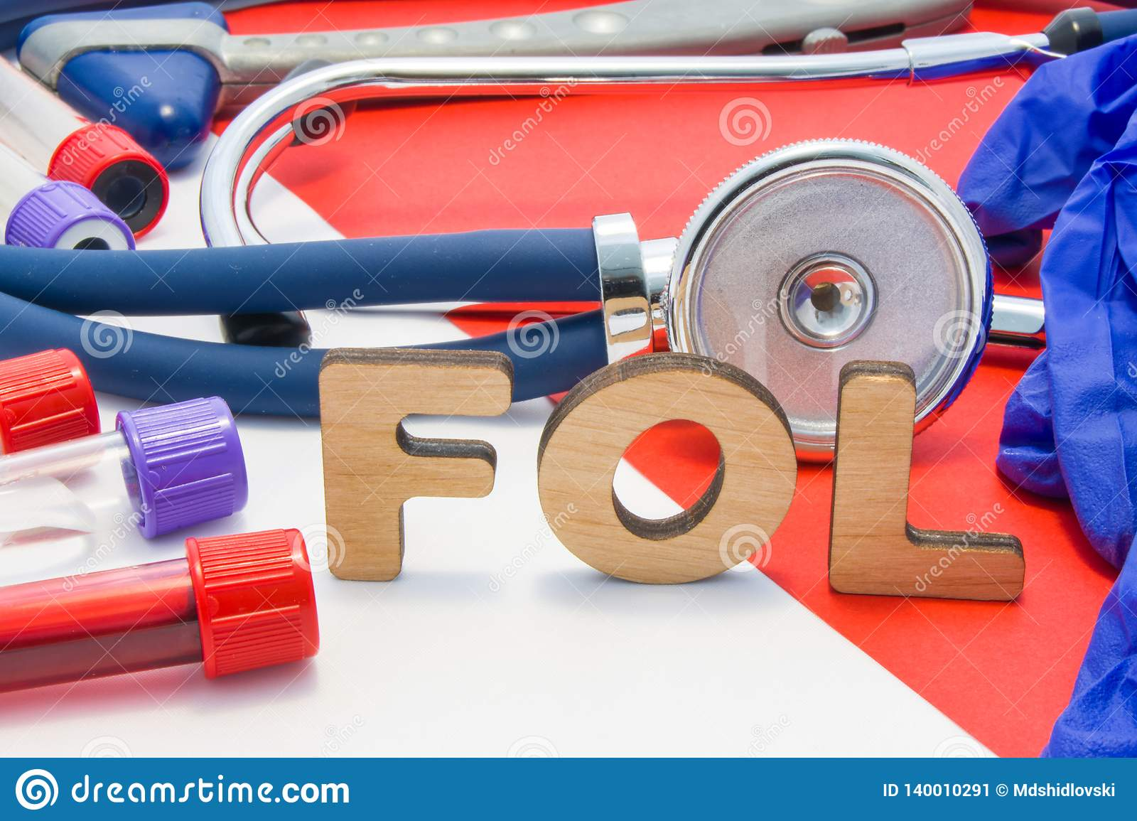 FOL medical abbreviation meaning total folate or folic acid in laboratory diagnostics on red background. Chemical name of FOL is s