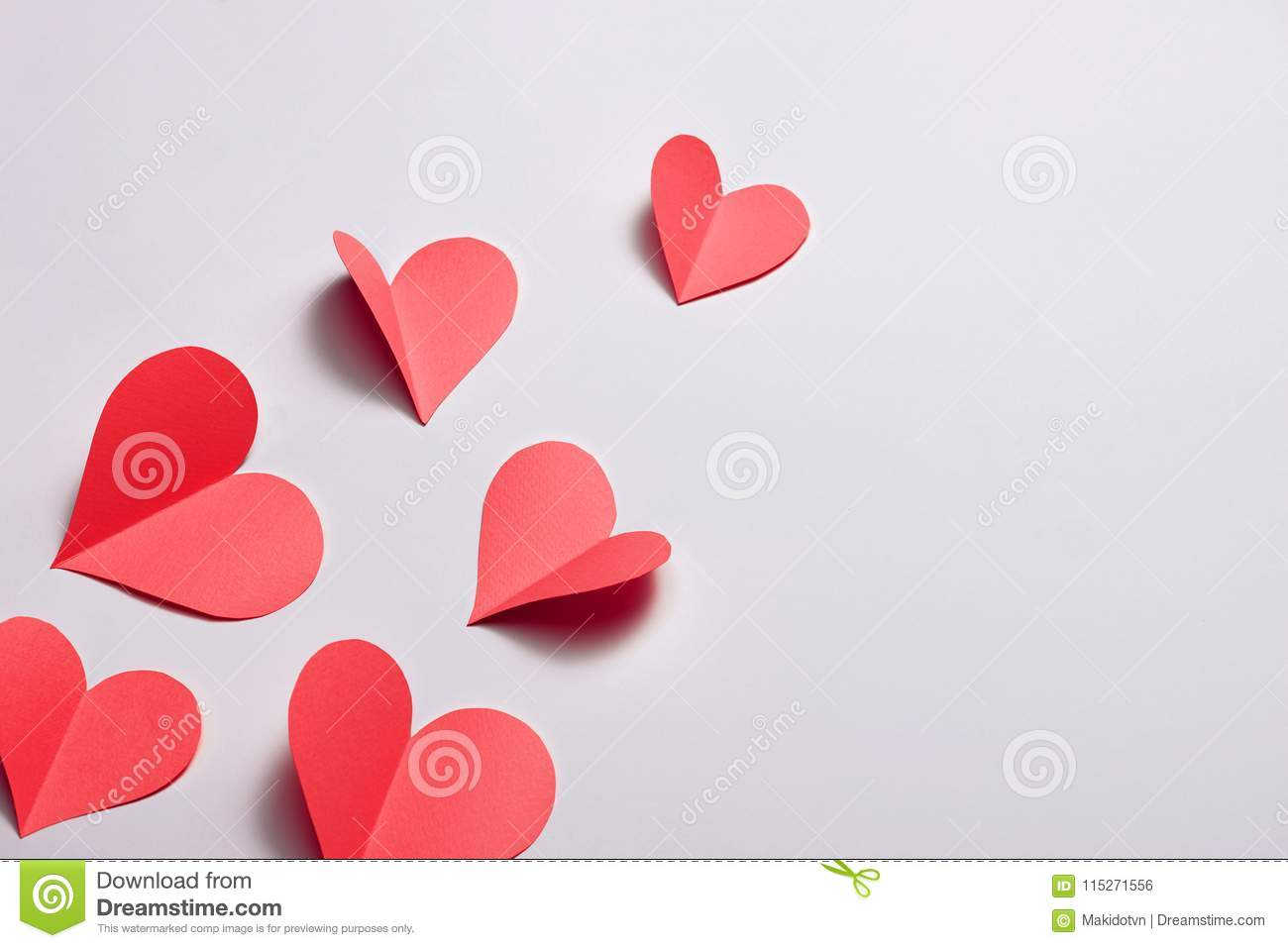 Fold paper Red hearts {Paper Heart cutting}, Heart of paper folding Isolated on White Background. Cards for Valentine`s Day There