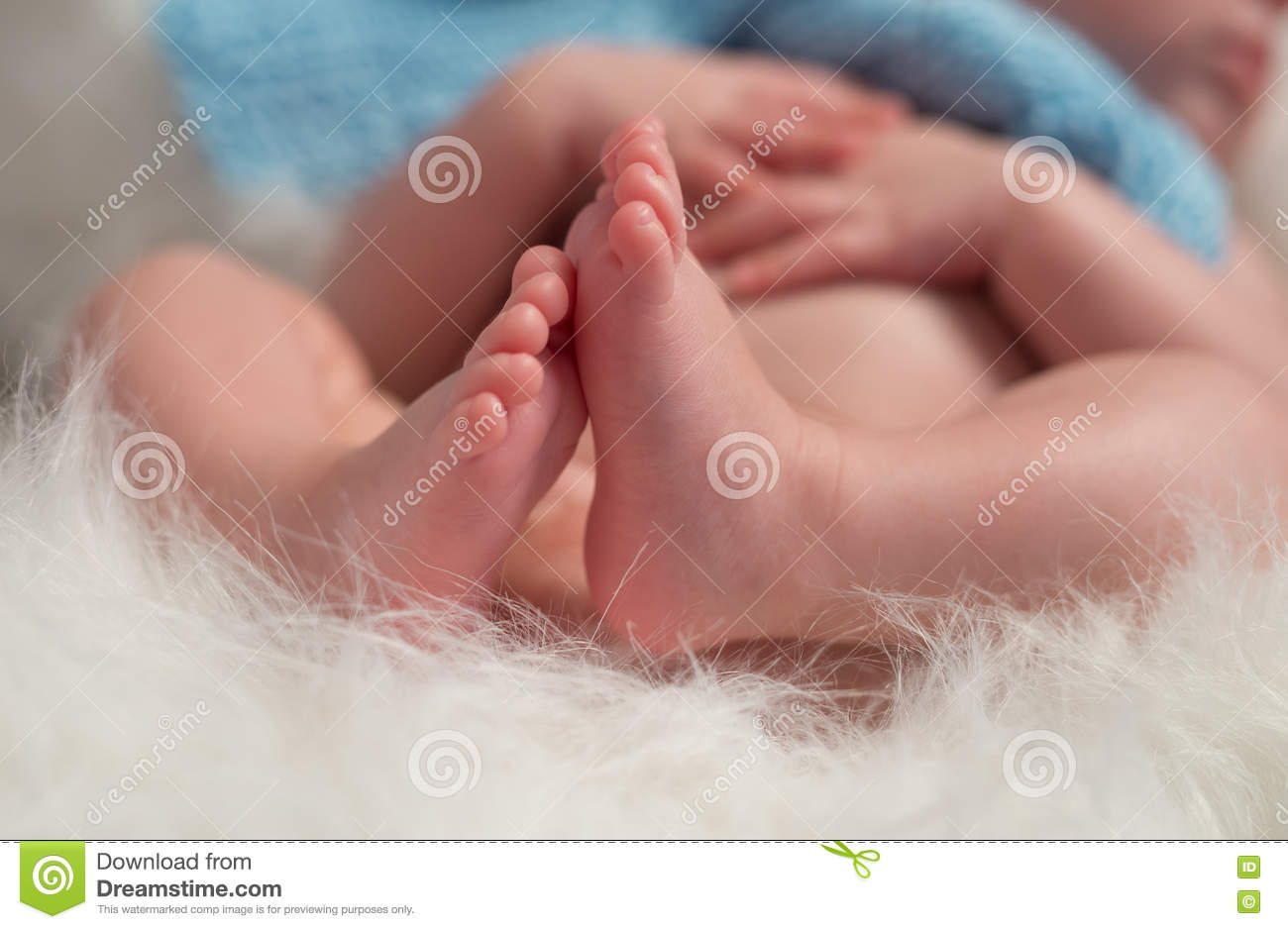 Folded legs of newborn baby closeup