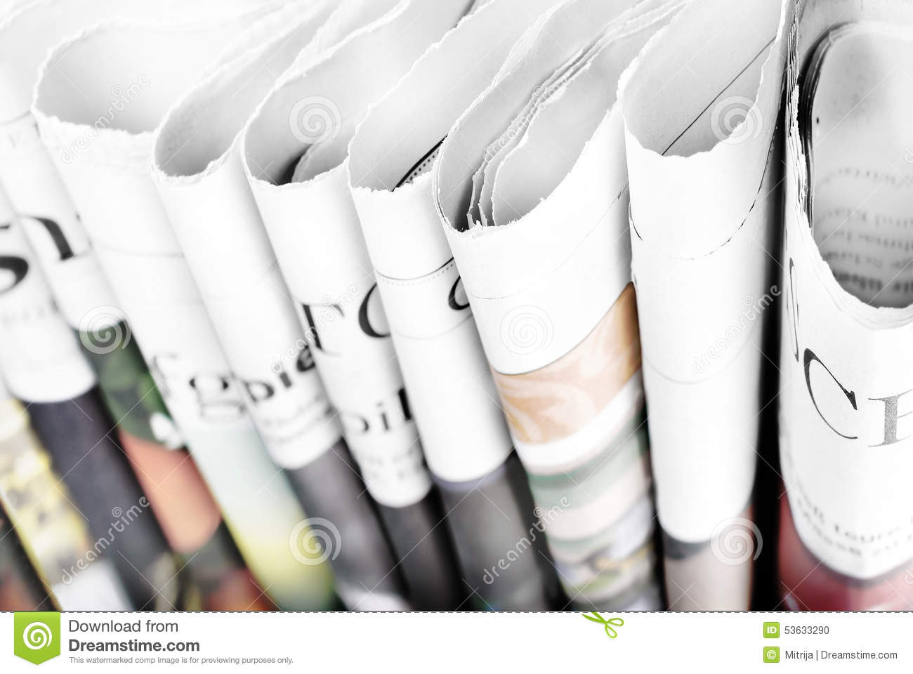Folded newspapers standing