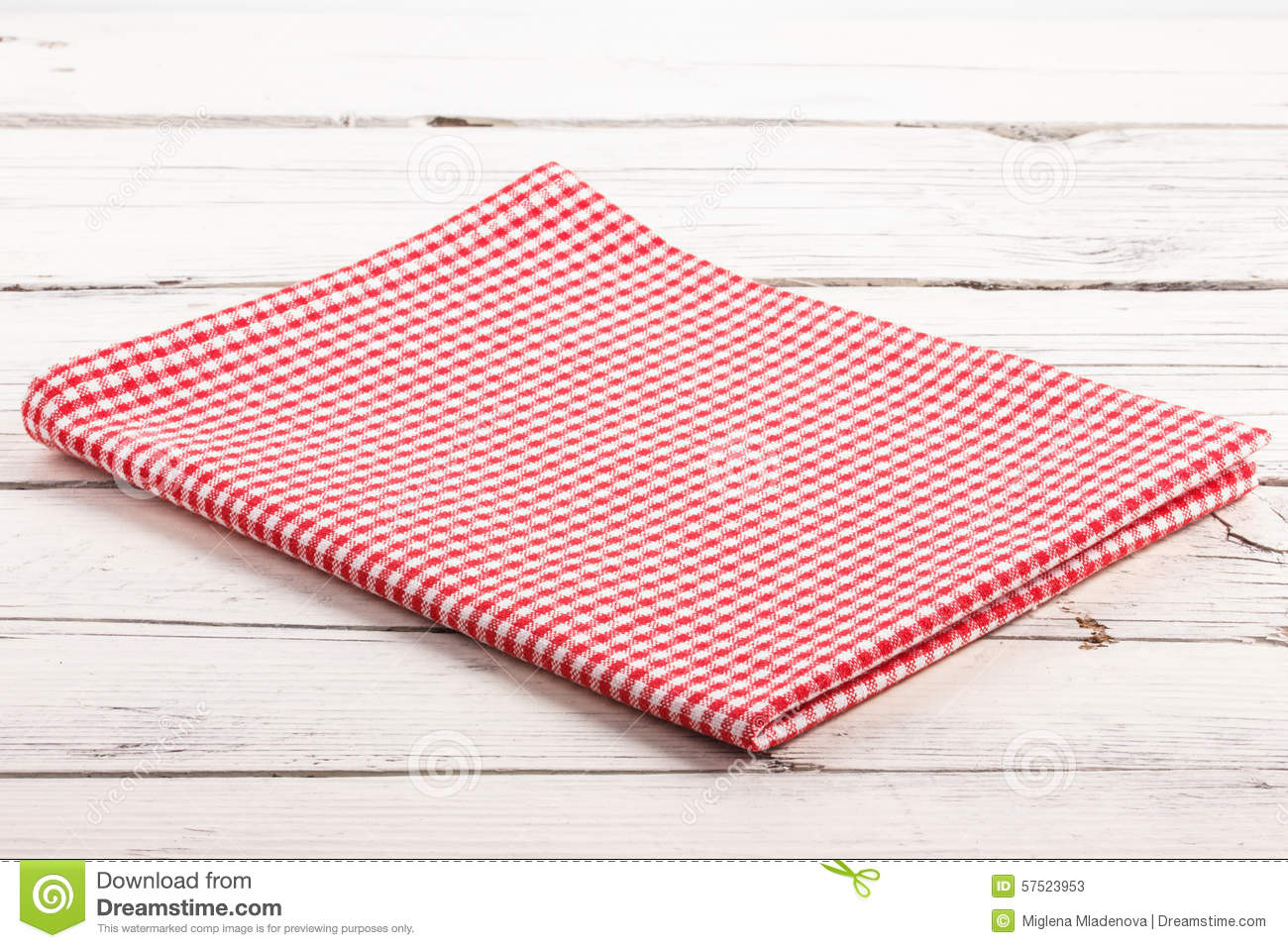 Folded Red Checkered Tablecloth On White Wooden Board