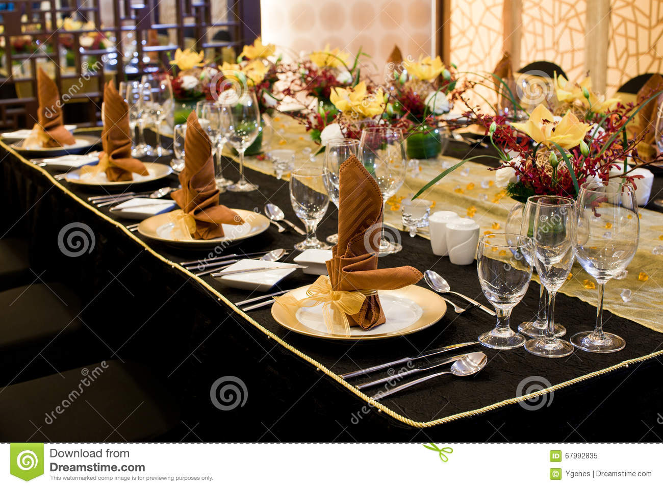 folded table napkin in formal table setting stock photo - image