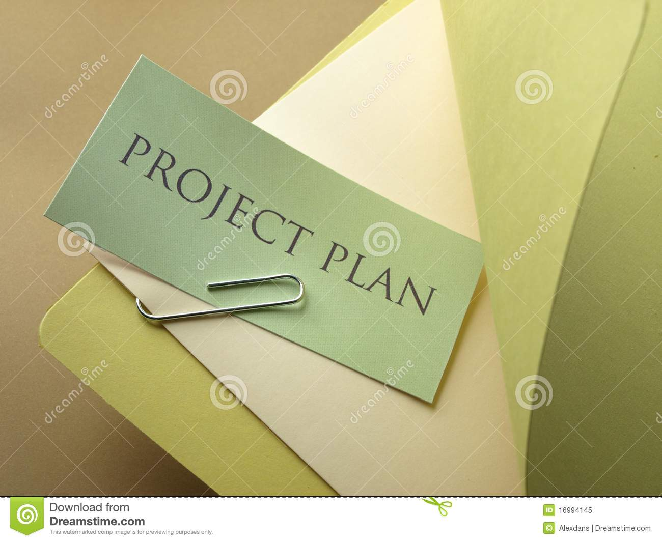 Photograph of the upper right of a folder, with a project plan.