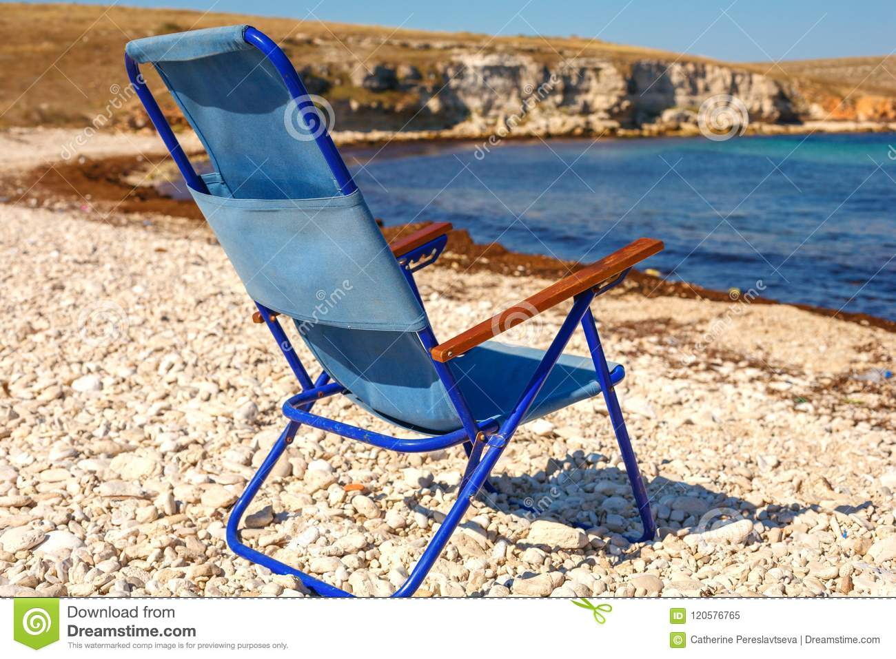 Admirable Folding Chair Stands On The Beach The Concept Of Vacation Ncnpc Chair Design For Home Ncnpcorg