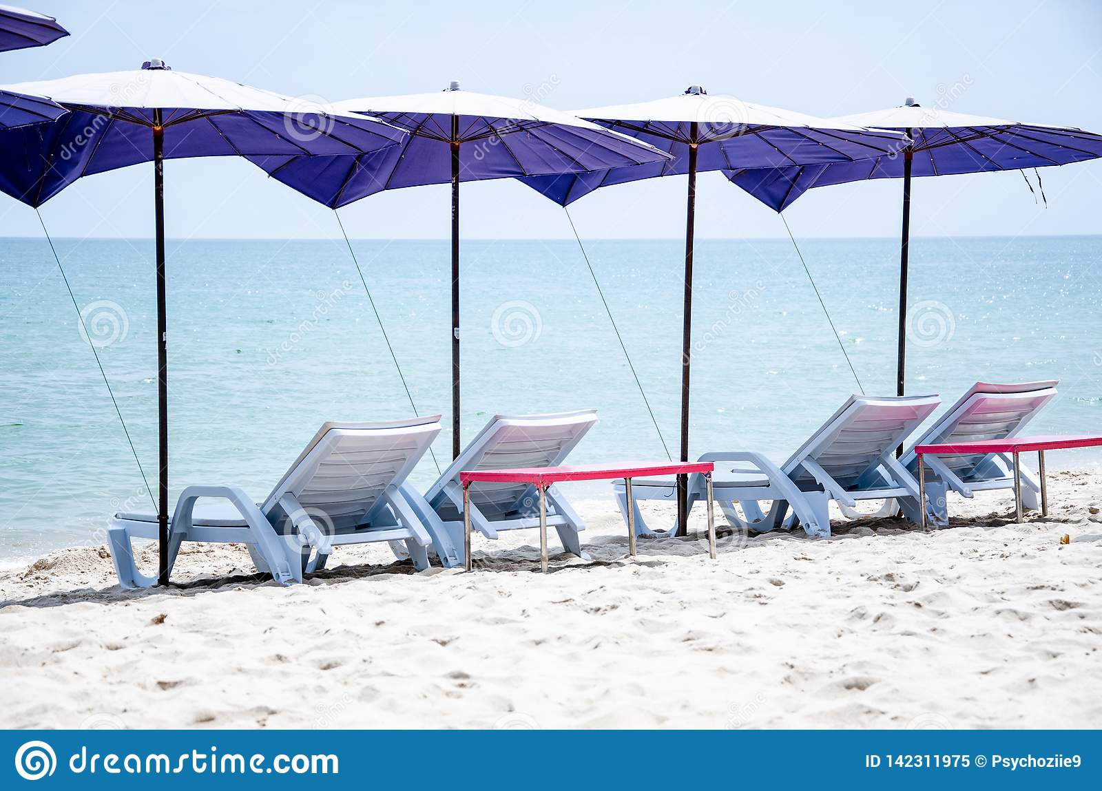 Incredible Folding Chairs With Umbrellas Are Located On The Beach For Gmtry Best Dining Table And Chair Ideas Images Gmtryco