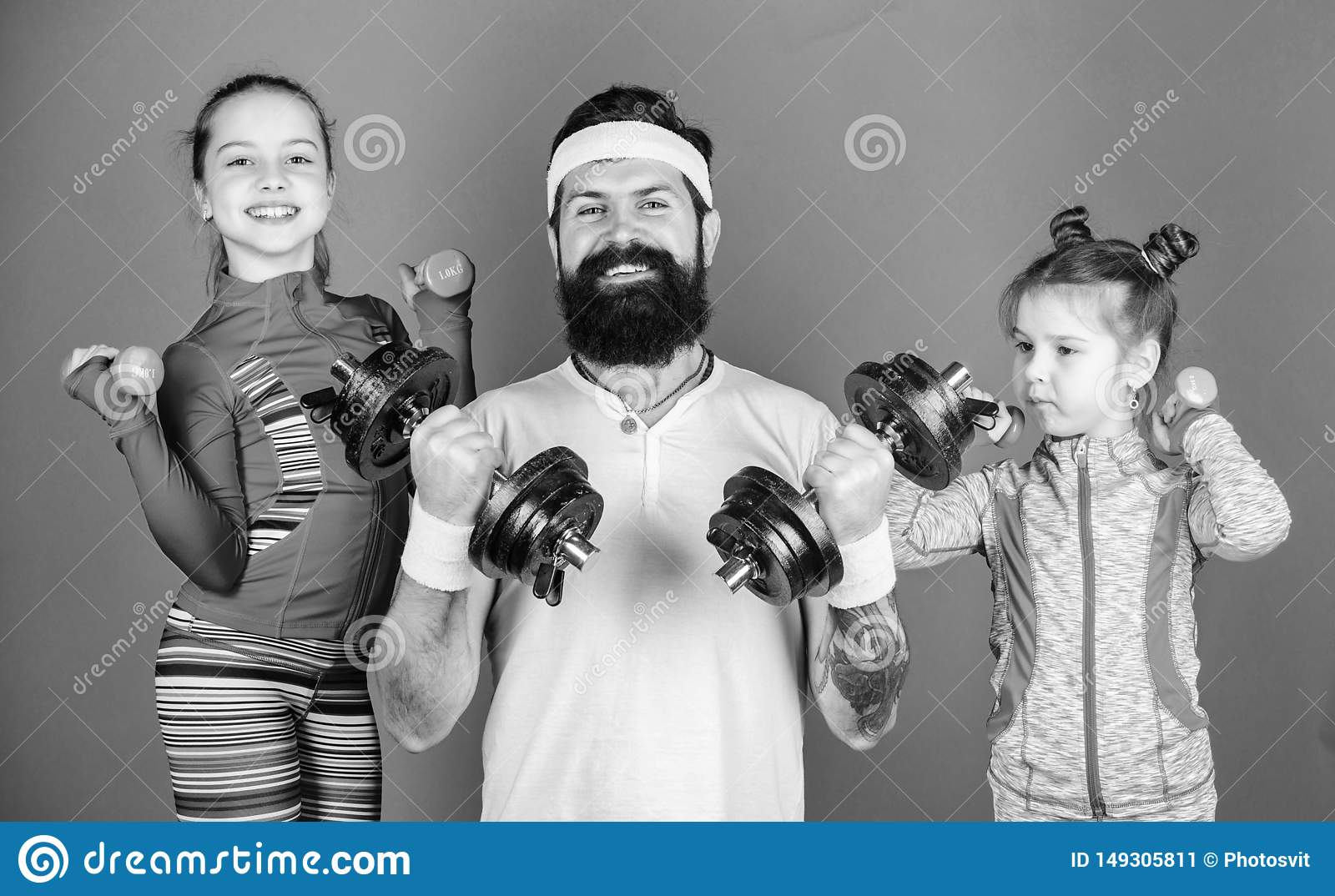 Follow father. Girls cute kids exercising with dumbbells with dad. Motivation and sport example concept. Children repeat