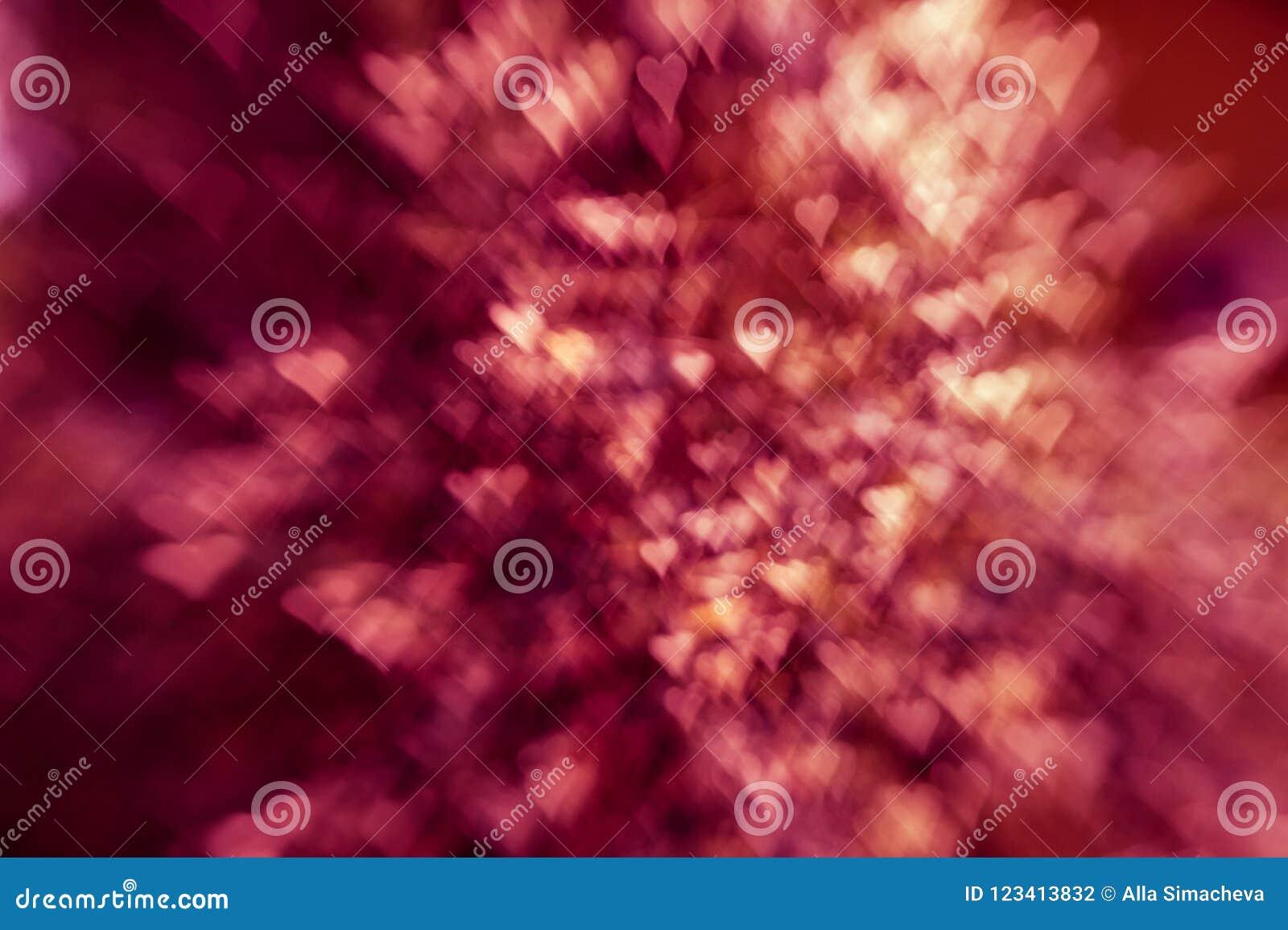 Fond abstrait élégant de fête avec la texture de lumières et de coeurs de bokeh
