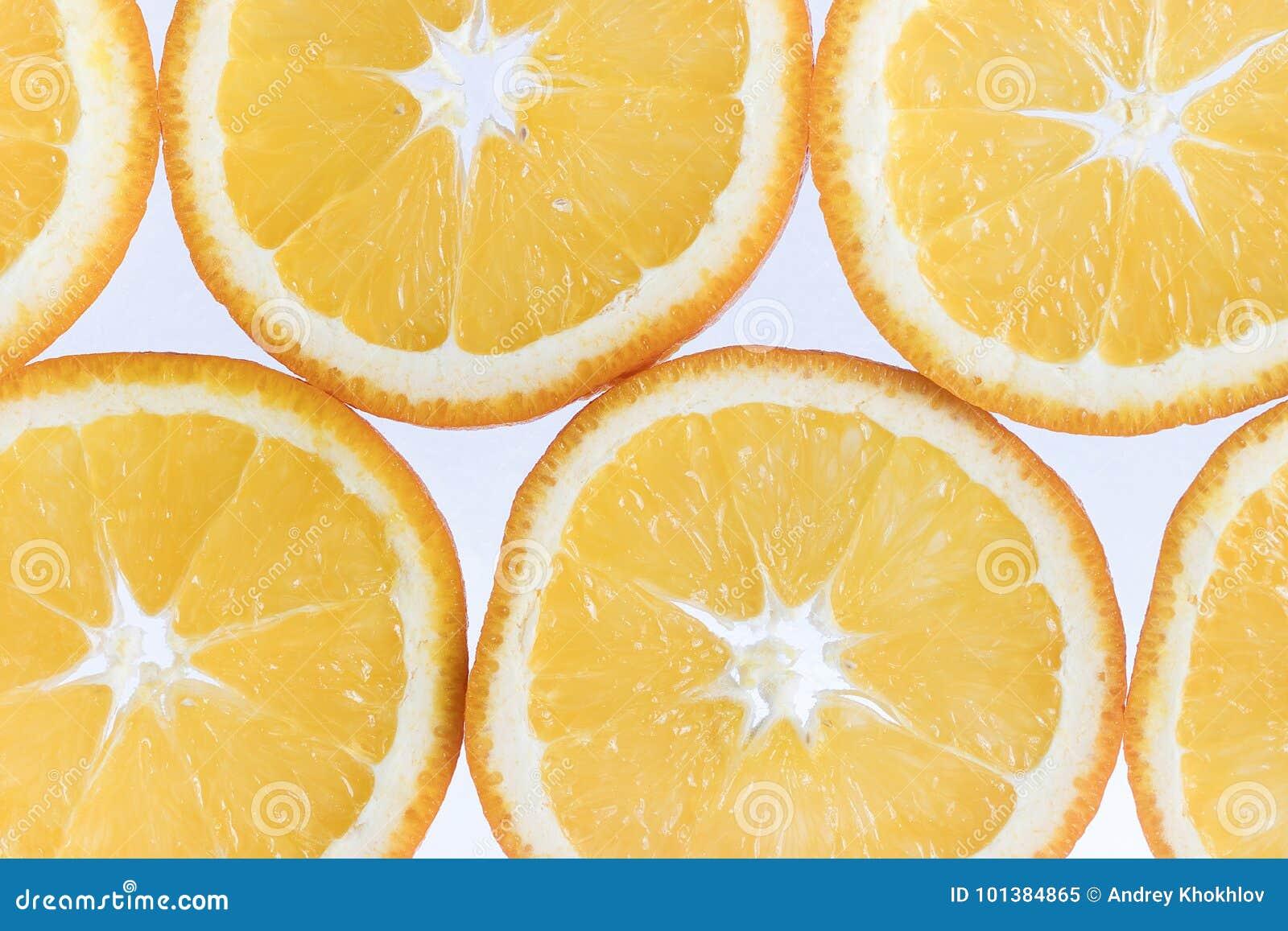 Fond abstrait avec des agrumes des parts oranges Plan rapproché Brosse à dents