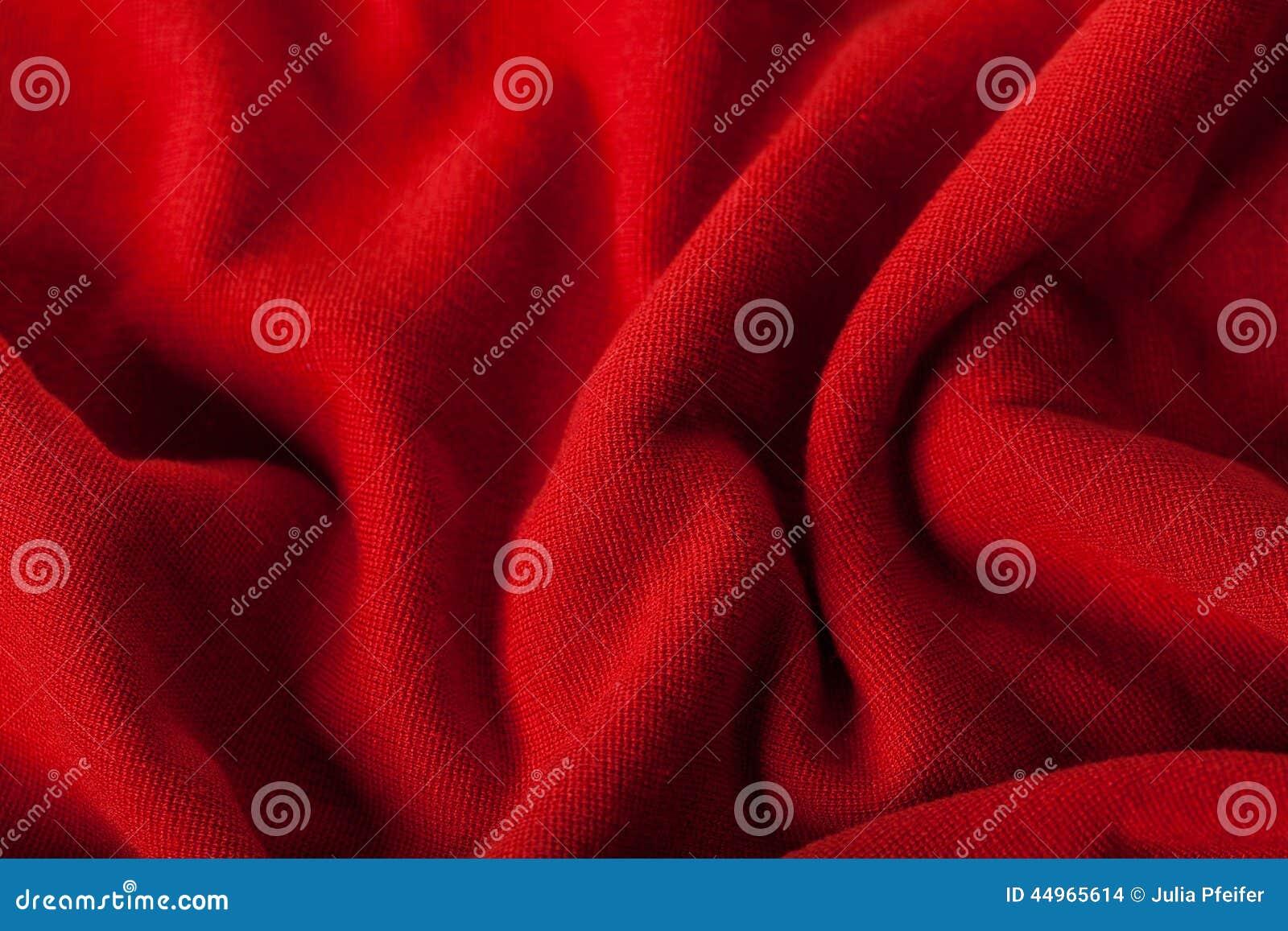 Fond abstrait de tissu rouge luxueux
