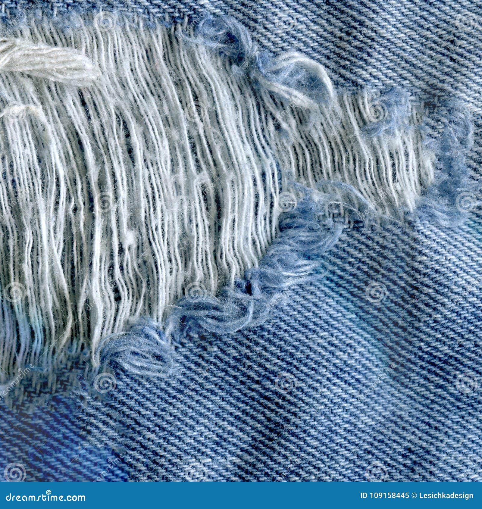 Fond bleu de Jean Texture de denim Texture de tissu déchirée par jeans