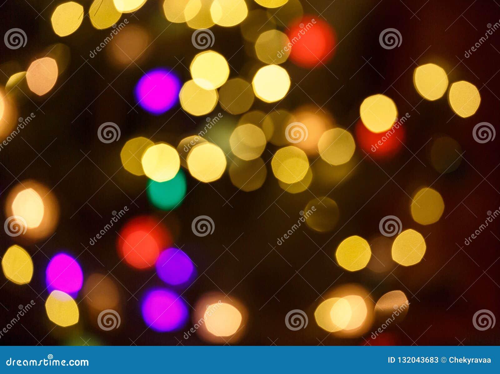 Fond clair abstrait de célébration avec les lumières d or defocused pour Noël, nouvelle année, vacances