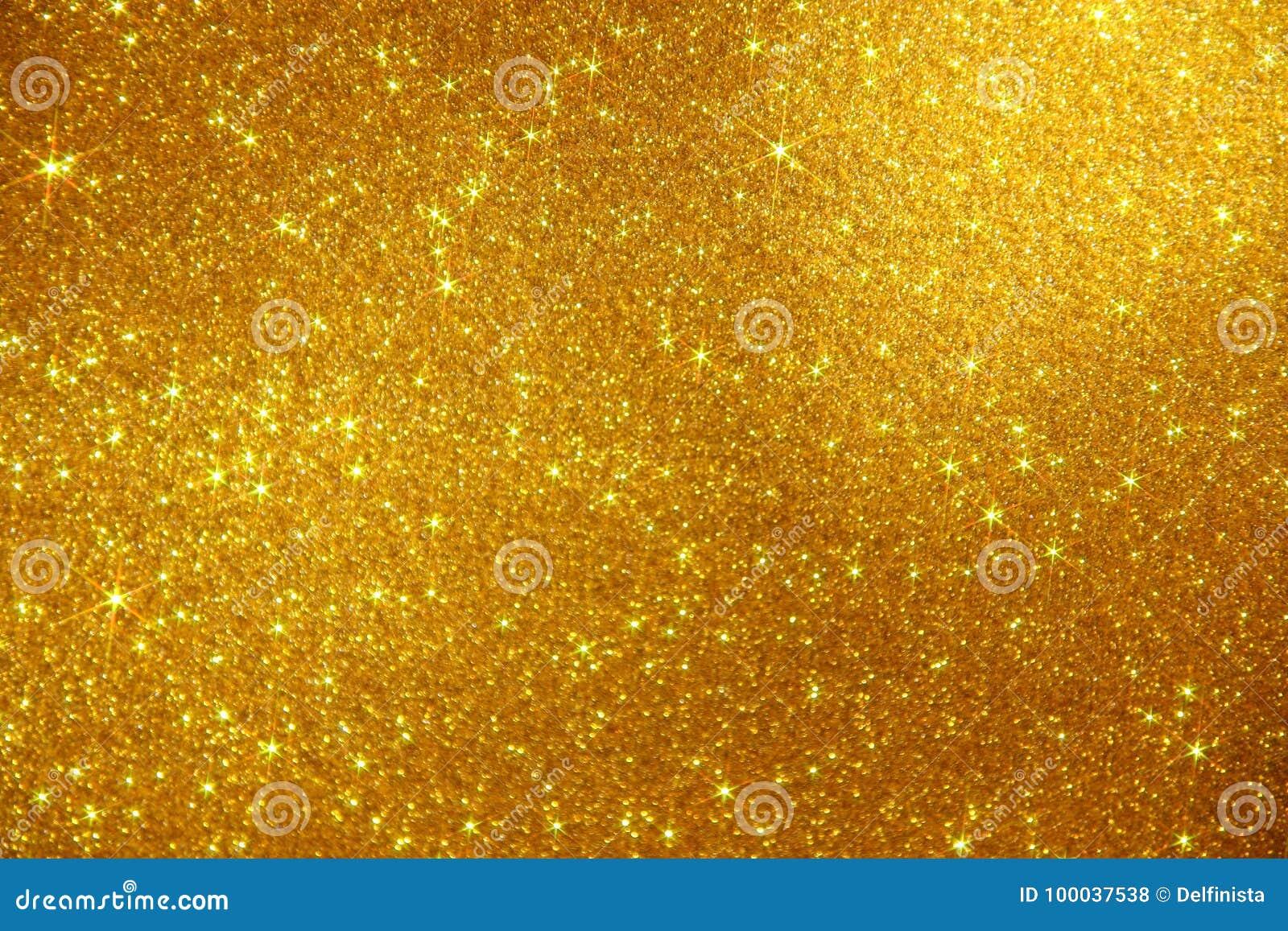 Fond d étincelle d étoiles de scintillement d or - photo courante