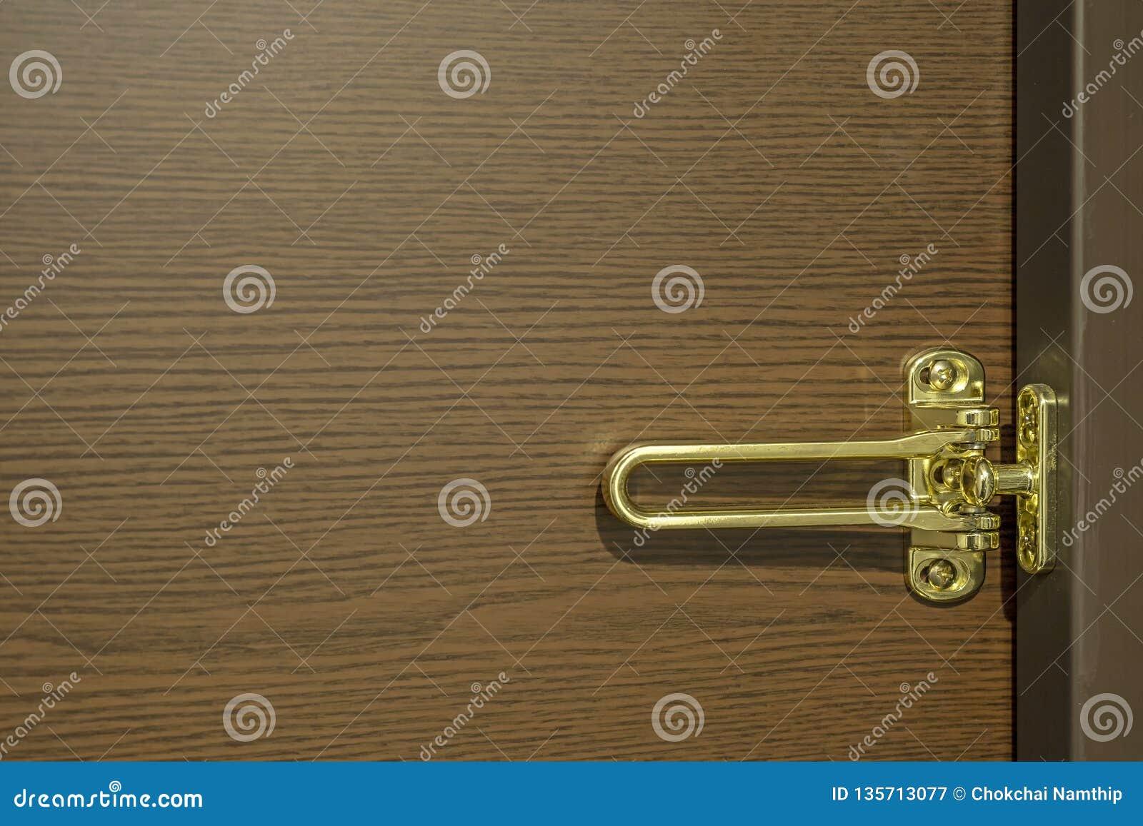 Fond d or de grain de verrou et en bois de porte