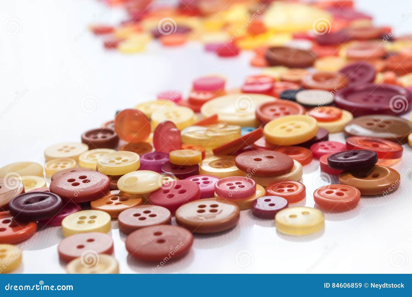 Fond de couture coloré de boutons