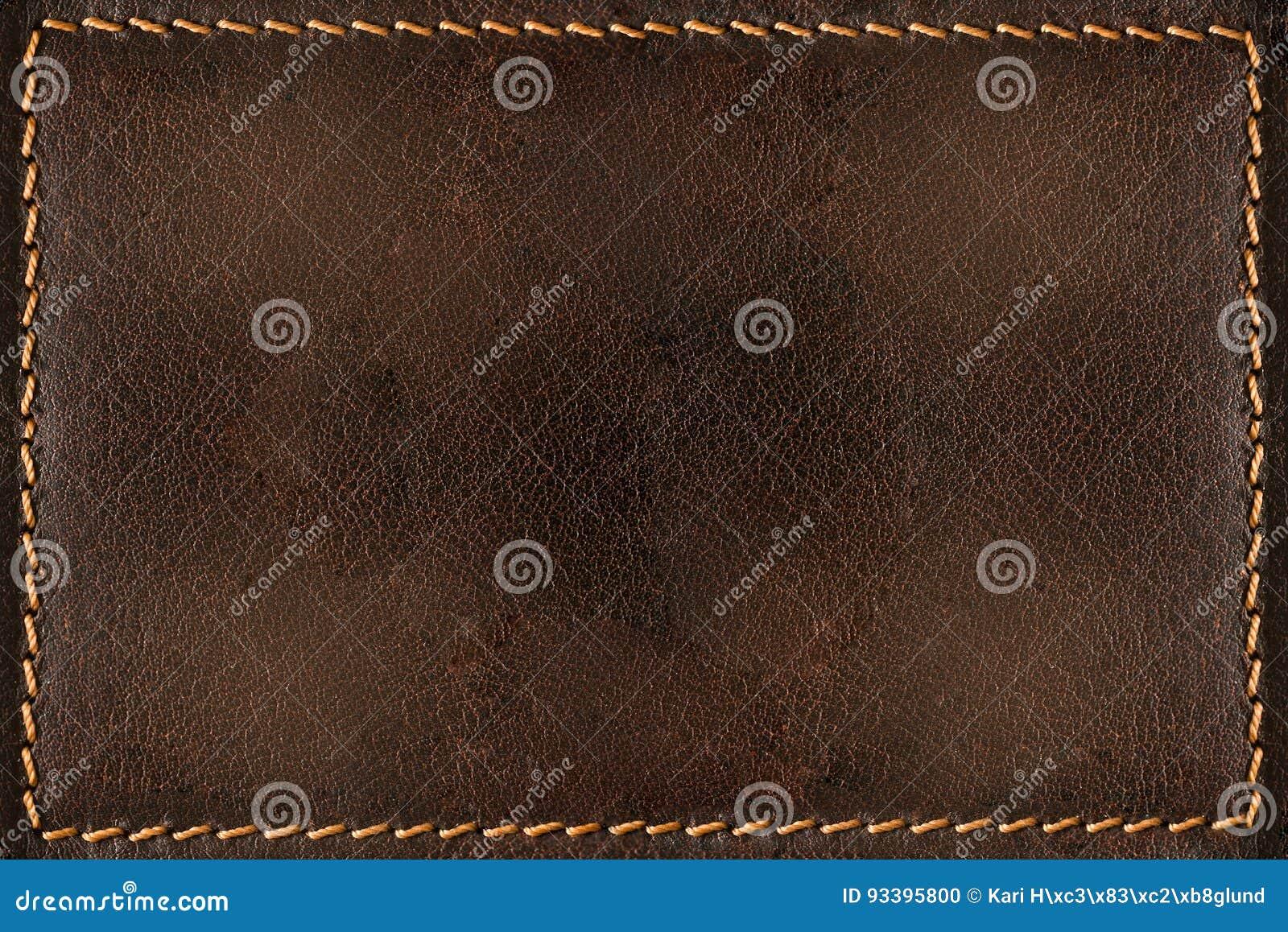 Fond de cuir de Brown avec des coutures
