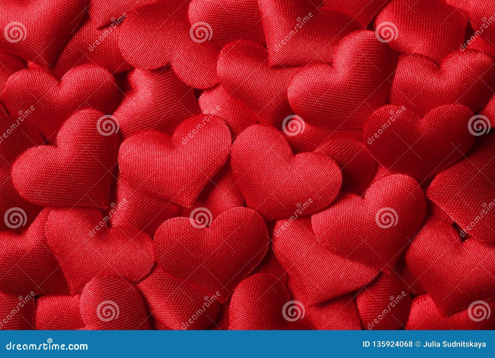 Fond de jour de Valentines avec les coeurs rouges