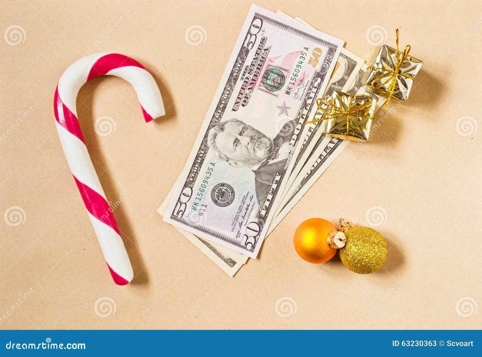 Fond de Noël avec le cadeau de candycane et d argent