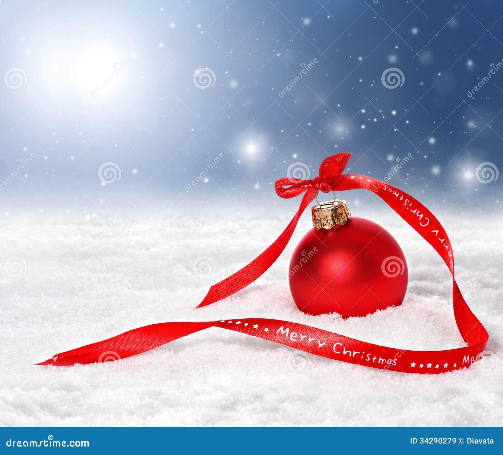 Fond de Noël avec le ruban de babiole rouge et de Joyeux Noël